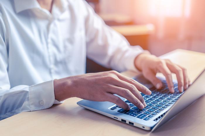 bigstock Businessman Hand Using Laptop  334832806 56 0.